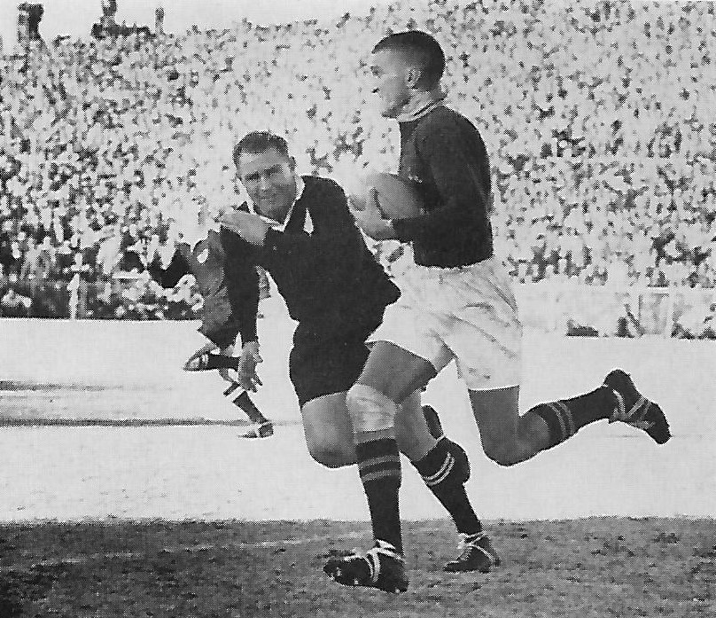 Hennie vamn Zyl running around Don Clarke for one of his onforgettable tries.
